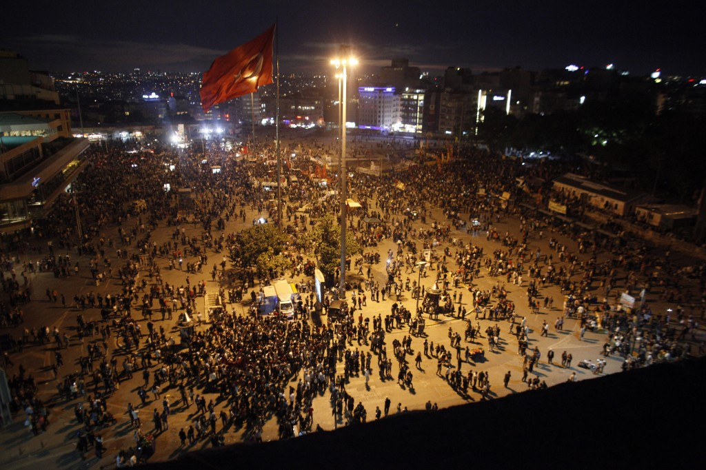 Protesters gather during a protest at Taksim Square in Istanbul, Tuesday. (AP Photo/Kostas Tsironis)