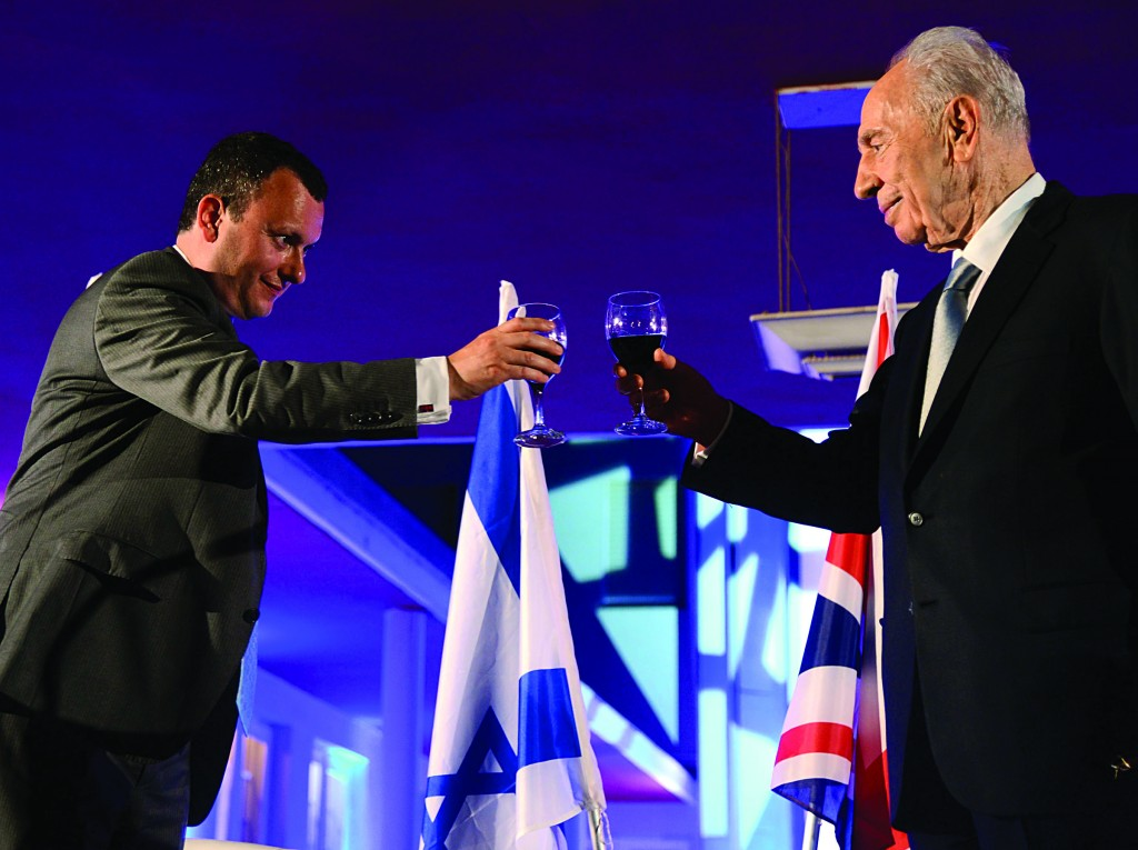 Israeli President Shimon Peres makes a toast with UK Ambassador Matthew Gould during a festive reception at the British embassy in Israel to mark the birthday of Her Majesty the Queen on Monday night. (Yossi Zeliger/Flash 90)