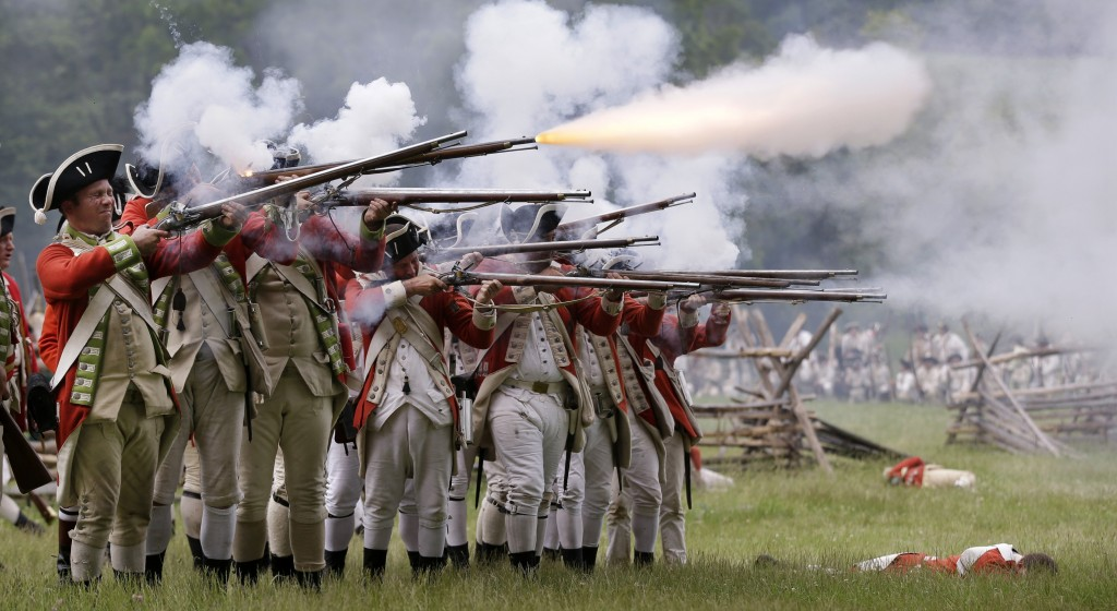 Re-enactors dressed as American colonial soldiers (right) advance on the British forces (left) during the 235th anniversary re-enactment of the Revolutionary War Battle of Monmouth on Sunday. (AP Photo/Mel Evans)