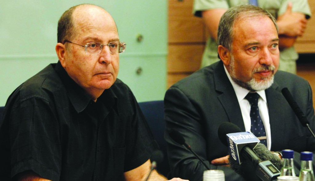 Israeli Defense Minister 'Boogie' Yaalon (L) made his debut briefing at the Knesset Foreign Affairs and Defense Committee on Monday. (Miriam Alster/Flash90)