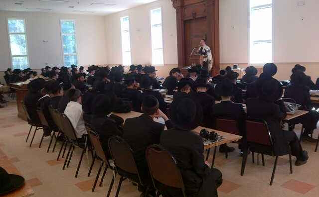 Harav Shimon Spiro, menahel of Mesivta Karlin Stolin, speaks after Shacharis in the new beis medrash on the camp's first day in Highland, N.Y. (JDN)