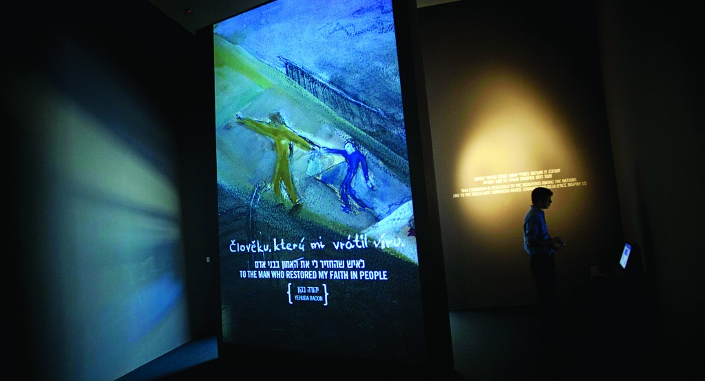 A visitor looks at a new exhibition dedicated to those who saved Jews during World War II at the Yad Vashem Holocaust Memorial in Jerusalem, Wednesday. (AP Photo/Sebastian Scheiner)