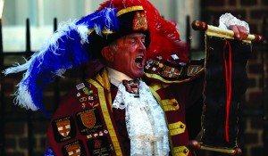 Tony Appleton, a town crier, announces the birth of the royal baby, outside St. Mary's Hospital's exclusive Lindo Wing in London, Monday. (AP Photo/Lefteris Pitarakis)