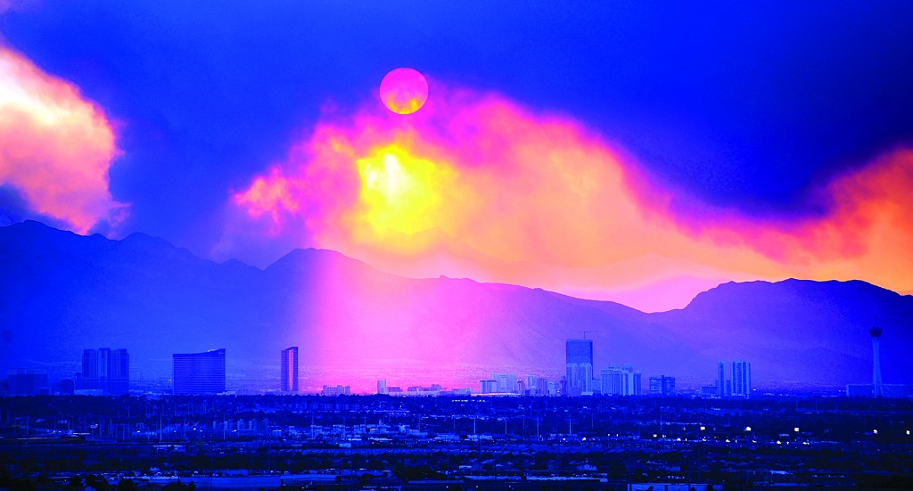 The Las Vegas Strip skyline is seen as smoke continues to billow from the Carpenter 1 fire on Mount Charleston on Monday in Las Vegas. (AP Photo/Las Vegas Review-Journal, David Becker)