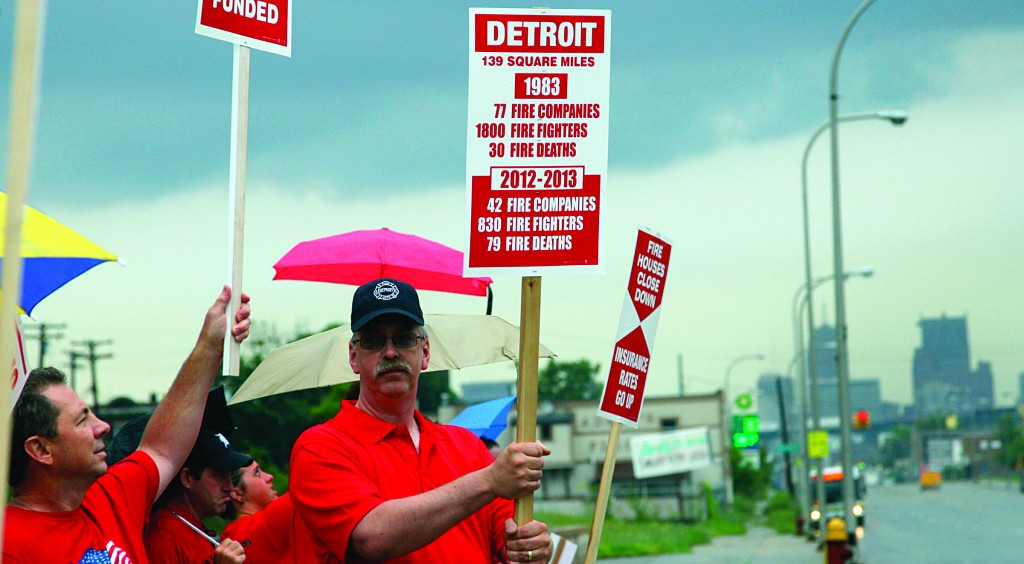 Detroit Fire Engine Operator Kevin Kelley (R) takes part in an informational picket to alert the public about the downsizing of the fire department in Detroit, Michigan Tuesday. (REUTERS/ Rebecca Cook)