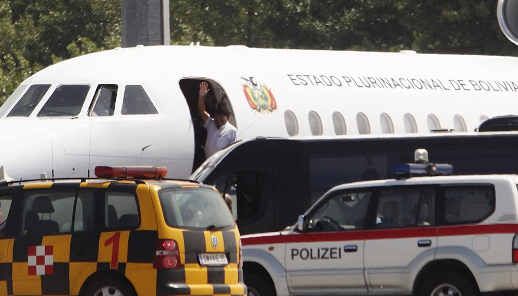 Bolivian President Evo Morales waves from his plane before leaving the Vienna International Airport in Schwechat. (REUTERS/Heinz-Peter Bader)