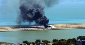 Asiana Airlines flight 214 just moments after crashing at San Francisco International Airport in San Francisco, Saturday. (AP Photo/Dawn Siadatan)