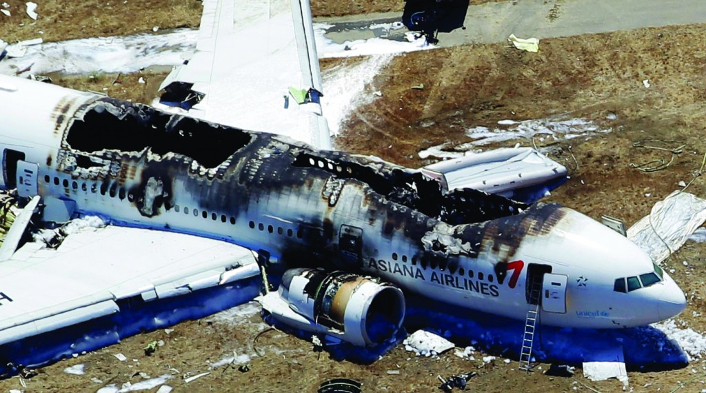 This photo shows the wreckage of Asiana Flight 214 after it crashed at San Francisco International Airport, Saturday. (AP Photo/Marcio Jose Sanchez)