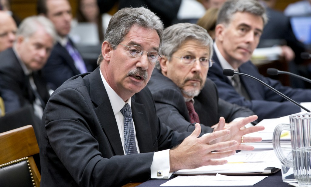 L-R: Deputy Attorney General James Cole, Robert S. Litt; general counsel in the Office of Director of National Intelligence; and National Security Agency Deputy Director John C. Inglis testify at a House Judiciary hearing on domestic spying on Capitol Hill in Washington, Wednesday. (AP Photo/J. Scott Applewhite)