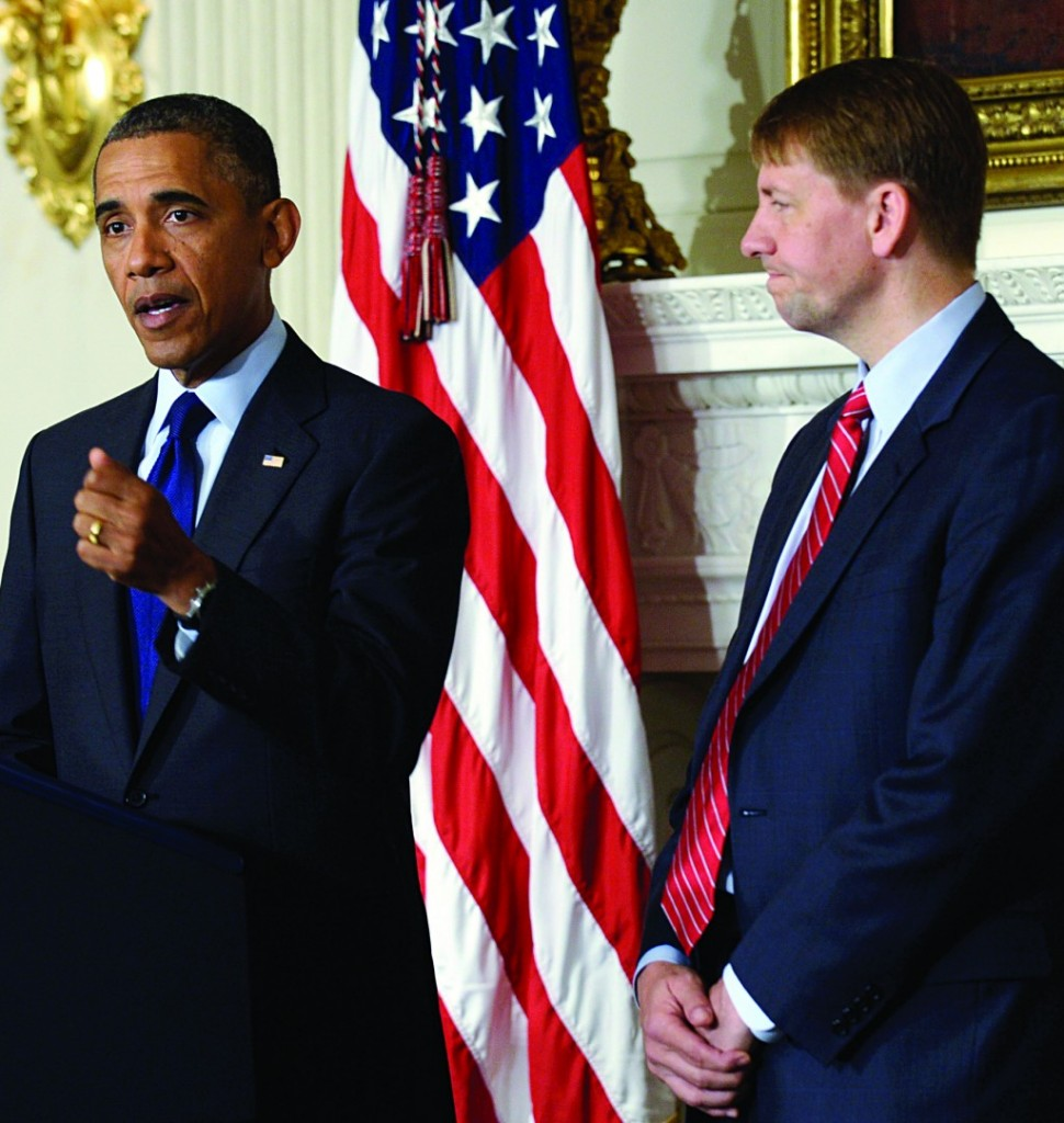 President Barack Obama, left, speaks as Richard Cordray, right, the new director of the Consumer Financial Protection Bureau, listens during a statement in the State Dining Room of the White House in Washington, Wednesday. The Democtratic-controlled Senate voted on Tuesday, July 16, 2013, to end a two-year Republican blockade that was preventing Cordray from winning confirmation as director of the Consumer Financial Protection Bureau. (AP Photo/Susan Walsh)