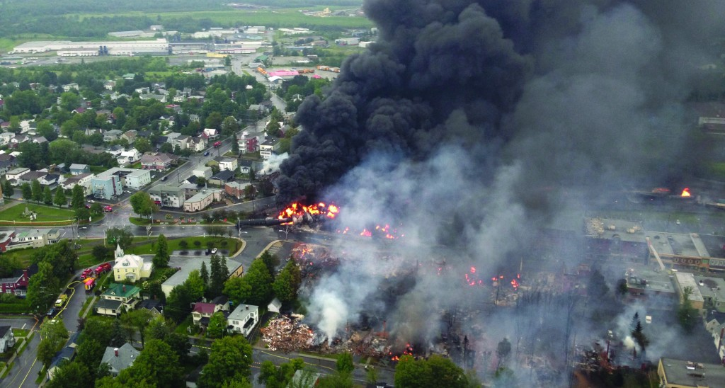 This aerial photo shows a fire in the town of Lac-Megantic, Quebec, as seen from a police helicopter following a train derailment that sparked several explosions. (AP Photo/Sûreté du Québec via The Canadian Press)