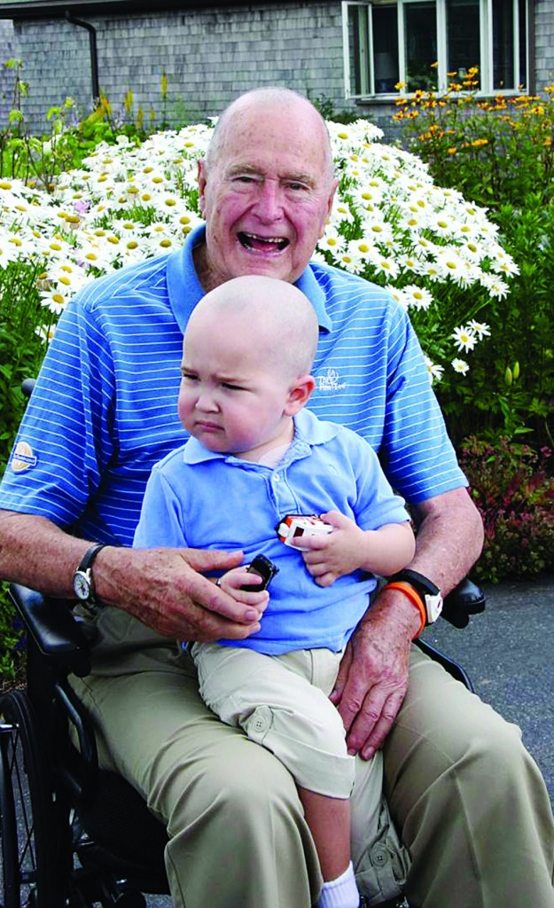 President George H. W. Bush with Patrick (last name withheld at family's request), 2, in Kennebunkport, Maine. (AP Photo/Office of George Bush)