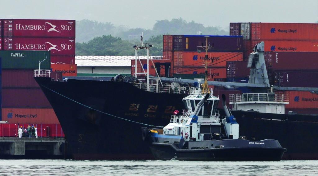 The North Korean-flagged cargo ship Chong Chon Gang, center, sits docked at the Manzanillo International container terminal on the coast of Colon City, Panama, Tuesday. (AP Photo/Arnulfo Franco)