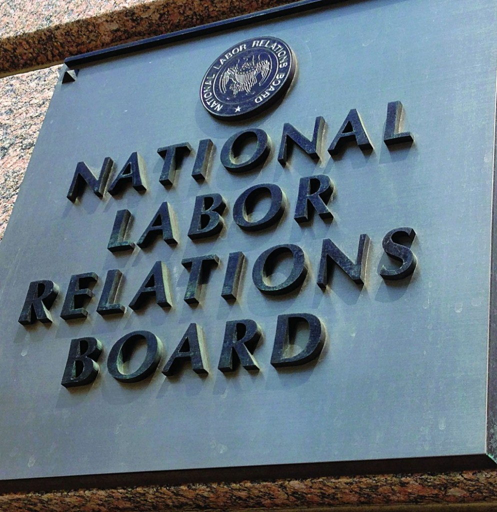 The sign for the National Labor Relations Board is seen on the building that houses their headquarters in downtown Washington, Wednesday. (AP Photo/Jon Elswick)
