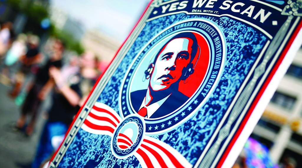"A protester in Frankfurt holds a placard with President Barack Obama and the phrase ""Yes, we scan"" during a demonstration against the National Security Agency and in support of whistleblower Edward Snowden over the weekend. (REUTERS/ Kai Pfaffenbach)"