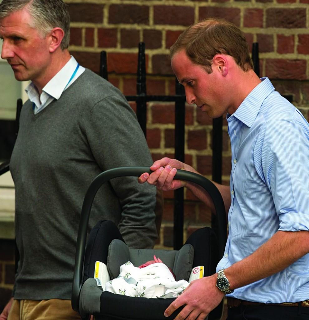 Britain's Prince William carries his newborn son in a car seat, Tuesday. (AP Photo/Matt Dunham)