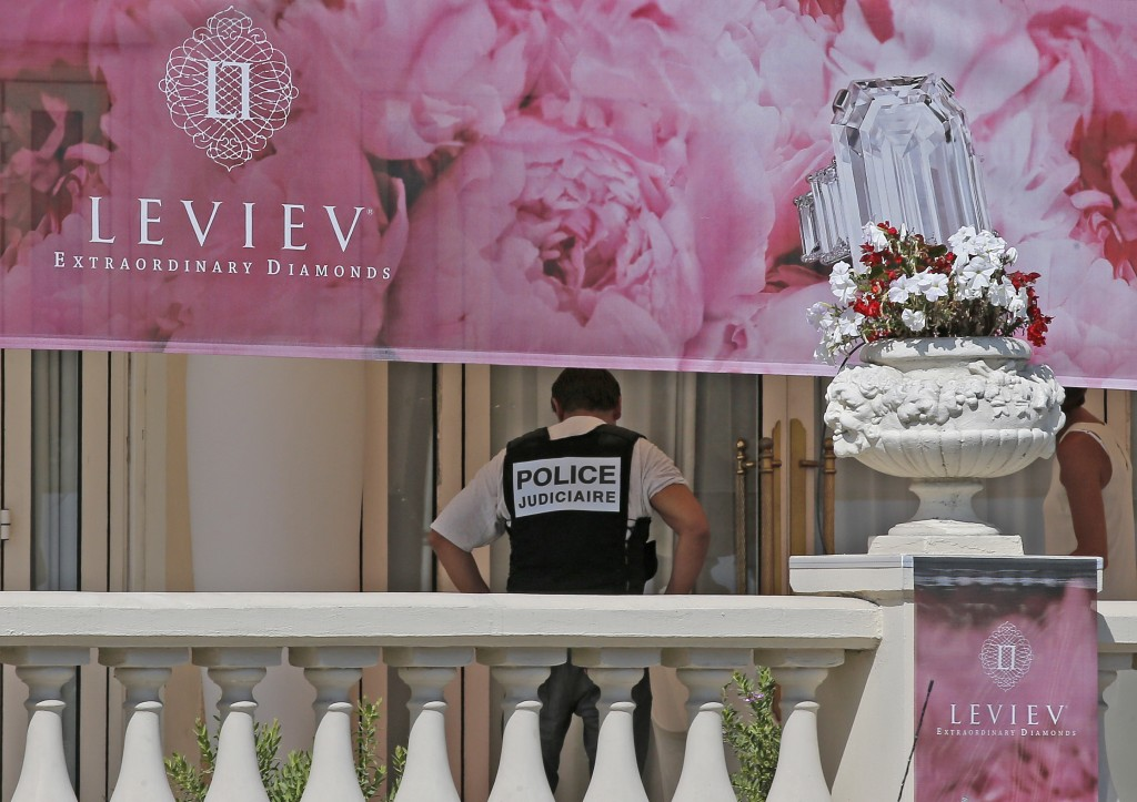 A policeman at the Carlton hotel, in Cannes, southern France, the scene of a daylight raid.(AP Photo/Lionel Cironneau)