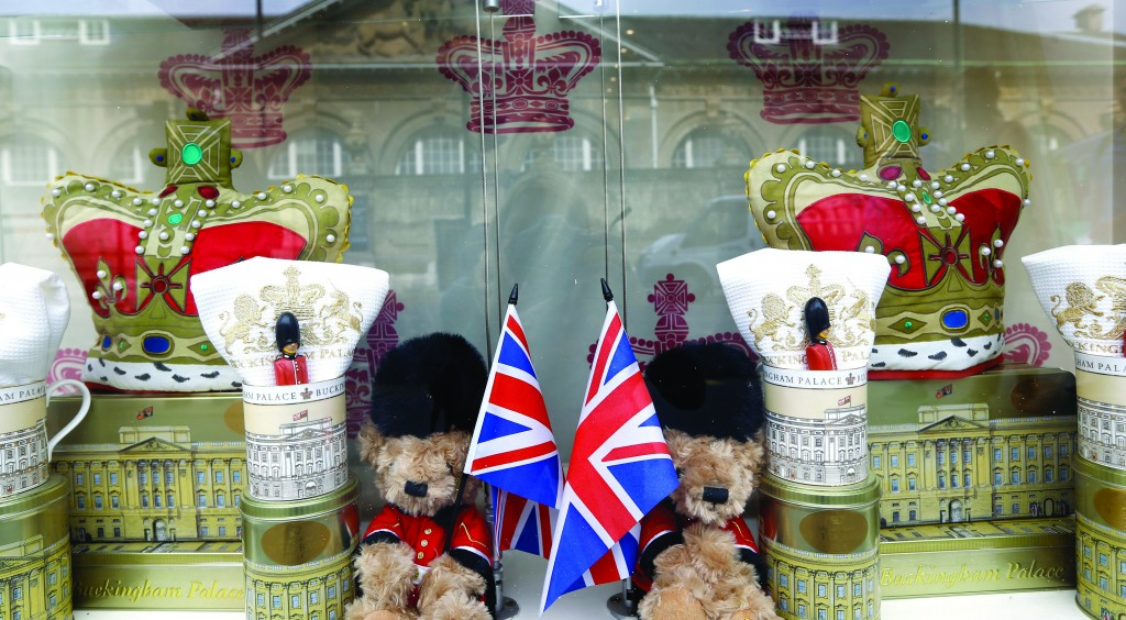 Buckingham Palace is reflected in the window of a souvenir shop selling teddy bears in London, Wednesday. (AP Photo/Kirsty Wigglesworth)