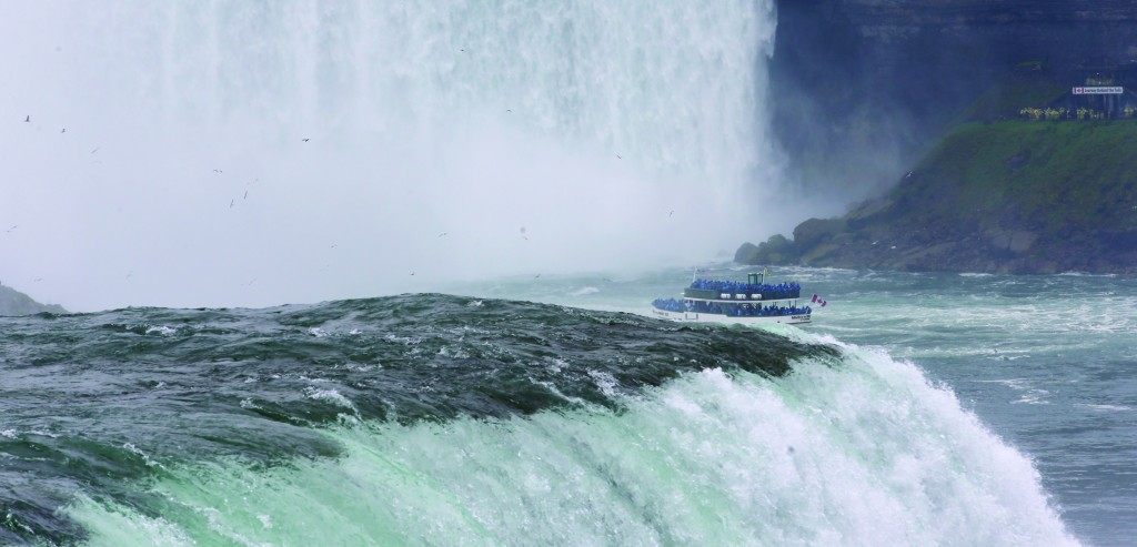 In this July 2 photo, people ride the Maid of the Mist tour boat in Niagara Falls, N.Y. (AP Photo/David Duprey)