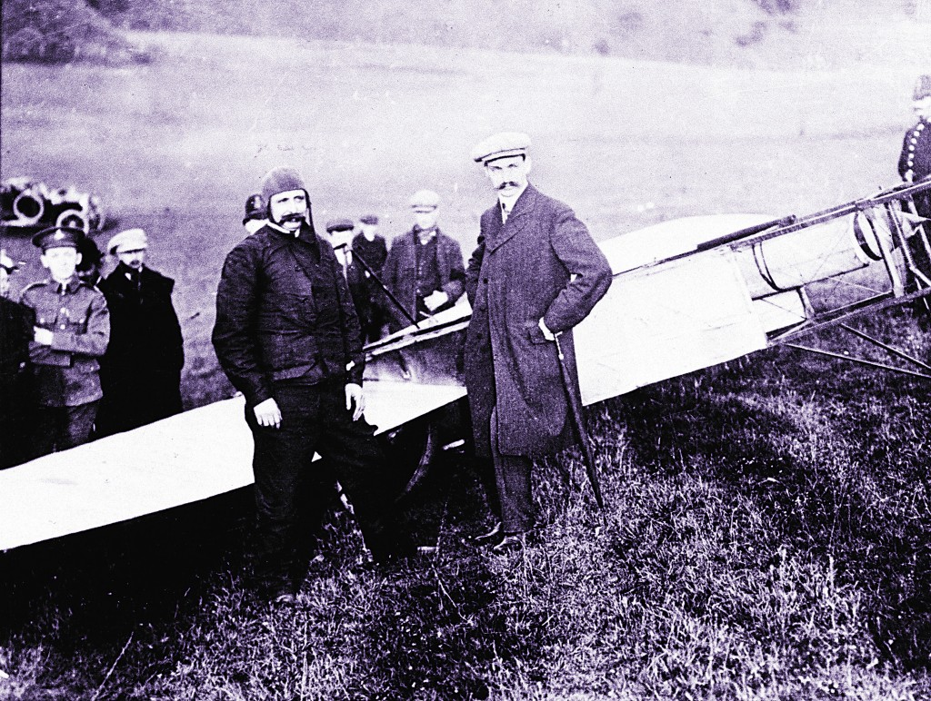 This July 25, 1909, photo shows French pilot and engineer Louis Bleriot (L), standing in front of his plane after flying across the English Channel and landing on a golf course near Dover, England. (AP Photo/file)