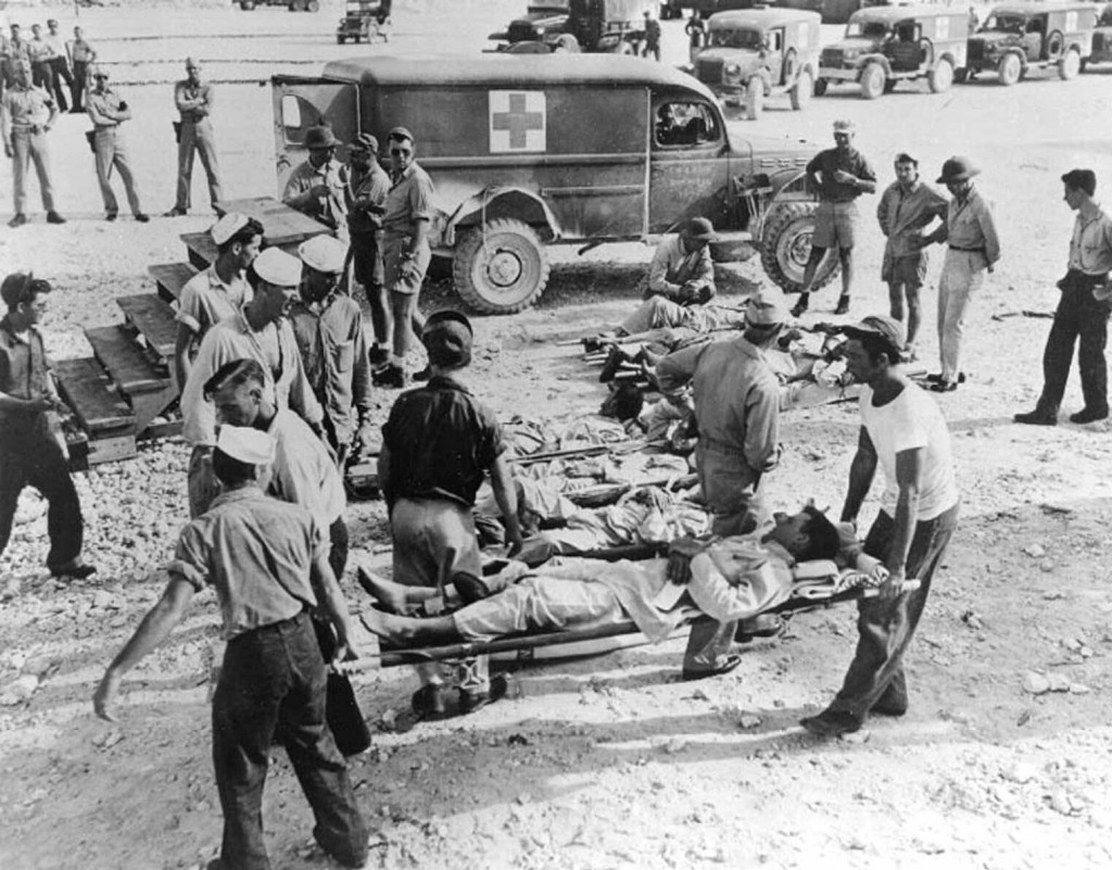 The USS Indianapolis survivors are shown on Guam. The survivors of the sinking of the USS Indianapolis on July 30, 1945, drifted aimlessly for nearly five days, battling thirst, exposure and ravenous sharks. Only 321 of the 1,196 crewmen were alive when the Navy, which hadn't realized the Indianapolis was missing, finally rescued them. (AP Photo/Naval Historical Center)