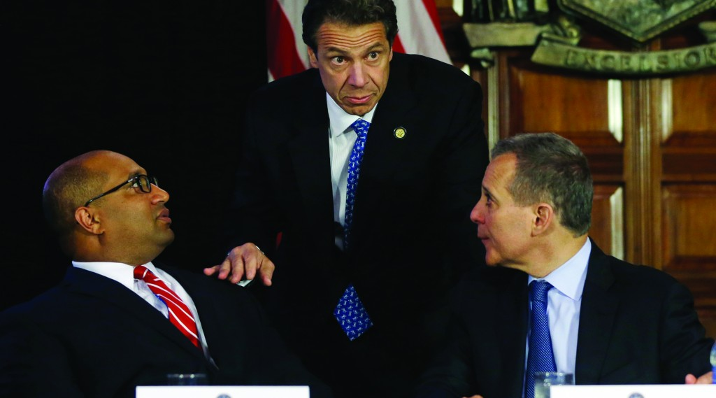 New York Gov. Andrew Cuomo, center, talks with Albany County District Attorney David Soares, left, and New York Attorney General Eric Schneiderman before a news conference at the Capitol Tuesday. (AP Photo/Mike Groll)