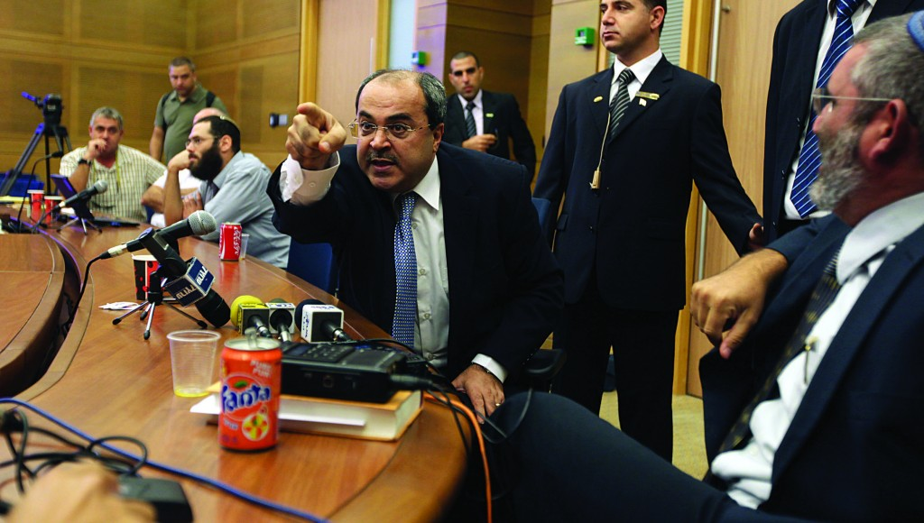 Arab Knesset member Ahmed Tibi (Ra'am-Ta'al) in an angry moment in the Knesset, one of many. He faces parliamentary discipline because he ripped up and poured water on a copy of a bill in the plenum. (Kobi Gideon / FLASH90)