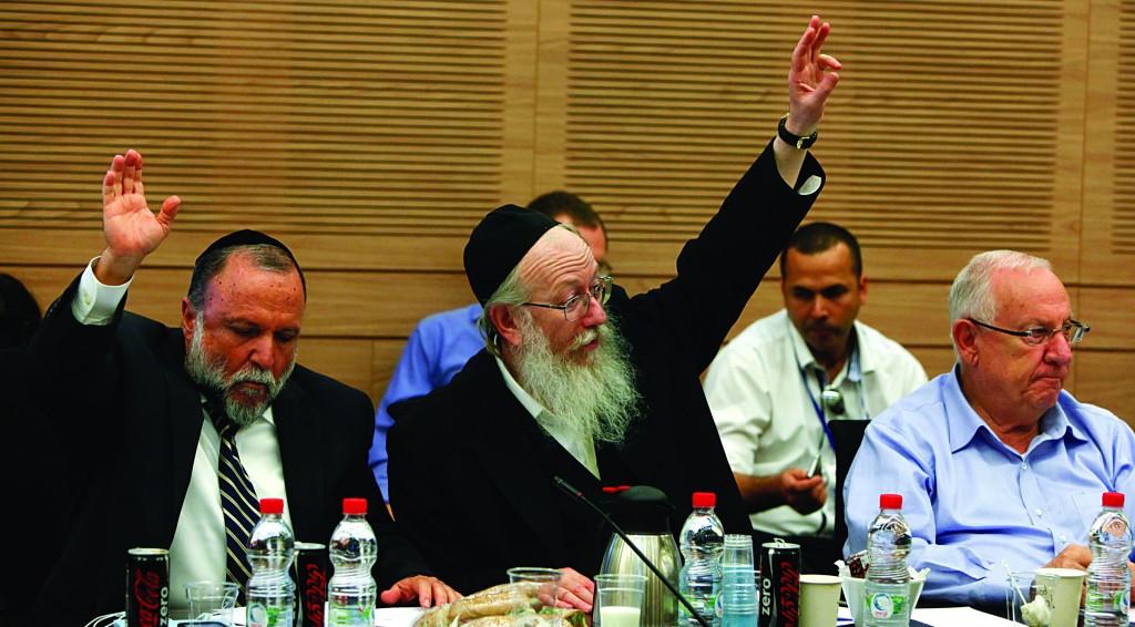 Shas MK Yitzchak Cohen (L), United Torah Judaism MK Rabbi Yaakov Litzman (C) and Likud MK Reuven Rivlin participating in the Finance Committee meeting on Wednesday. (Yonatan Sindel/Flash90)