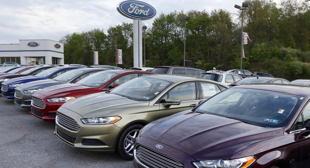 New 2013 Ford Fusions are seen at an automobile dealer in Zelienople, Pa. Sales from the major automakers are expected to show that confident U.S. buyers snapped up new cars and trucks at a strong pace in June. (AP Photo/Keith Srakocic)