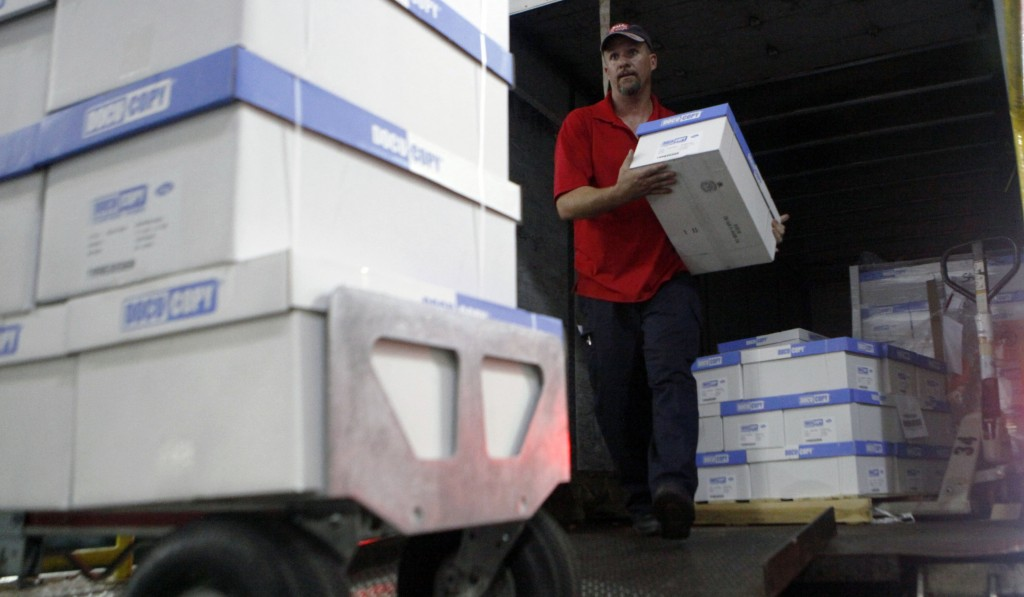 An SAIA employee unloads copy paper from a delivery truck at Centennial Tower in downtown Atlanta Friday. Temporary workers, in fields such as manufacturing, health care and teaching, have jumped more than 50 percent since the recession ended four years ago, to nearly 2.7 million. (AP Photo/Jaime Henry-White)