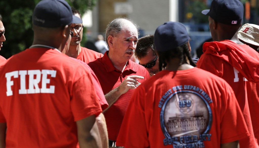 In this July 24, 2013 file photo, Dan McNamara, president of the Detroit Fire Fighters Association, speaks to firefighters outside the Theodore Levin United States Courthouse in Detroit. Detroit's historic bankruptcy filing is a major setback for public sector unions that have spent years trying to ward off cuts to the pensions and benefits of government workers. (AP Photo/Paul Sancya)