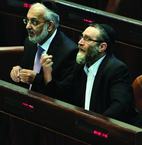 United Torah Judaism MK Rabbi Moshe Gafni (R) seen reacting in the Knesset plenum on Wednesday.(Miriam Alster/FLASH90)