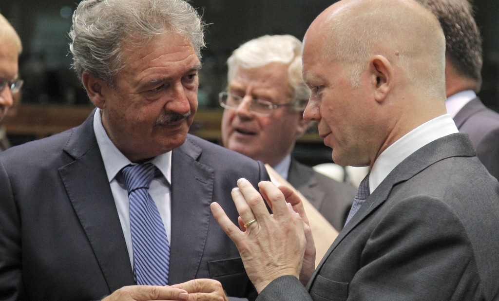 British Foreign Secretary William Hague (R) talks with Luxembourg's Foreign Minister Jean Asselborn during the EU foreign ministers meeting at the European Council building in Brussels, Monday. (AP Photo/Yves Logghe)
