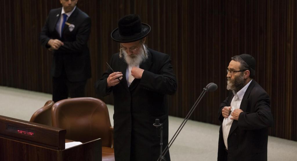 MKs Yisrael Eichler and Moshe Gafni tearing kriah.