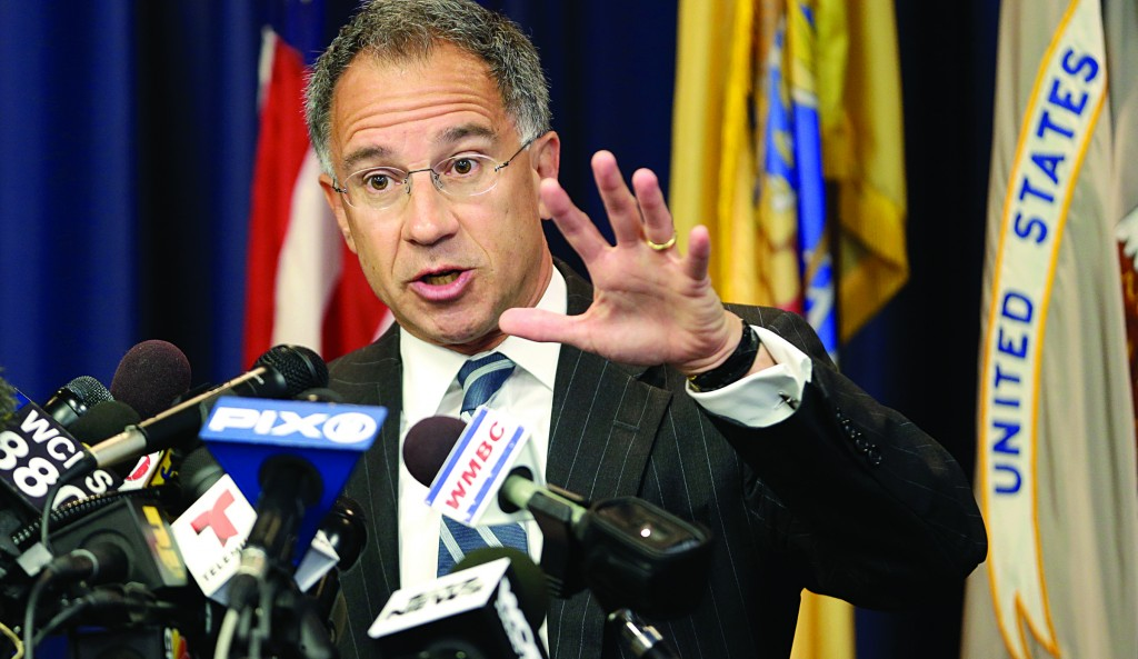 U.S. Attorney Paul Fishman talks about the arrest of four Russians and a Ukrainian, who have been charged with running a sophisticated hacking organization during a news conference, Thursday, in Newark, N.J. (AP Photo/Julio Cortez)