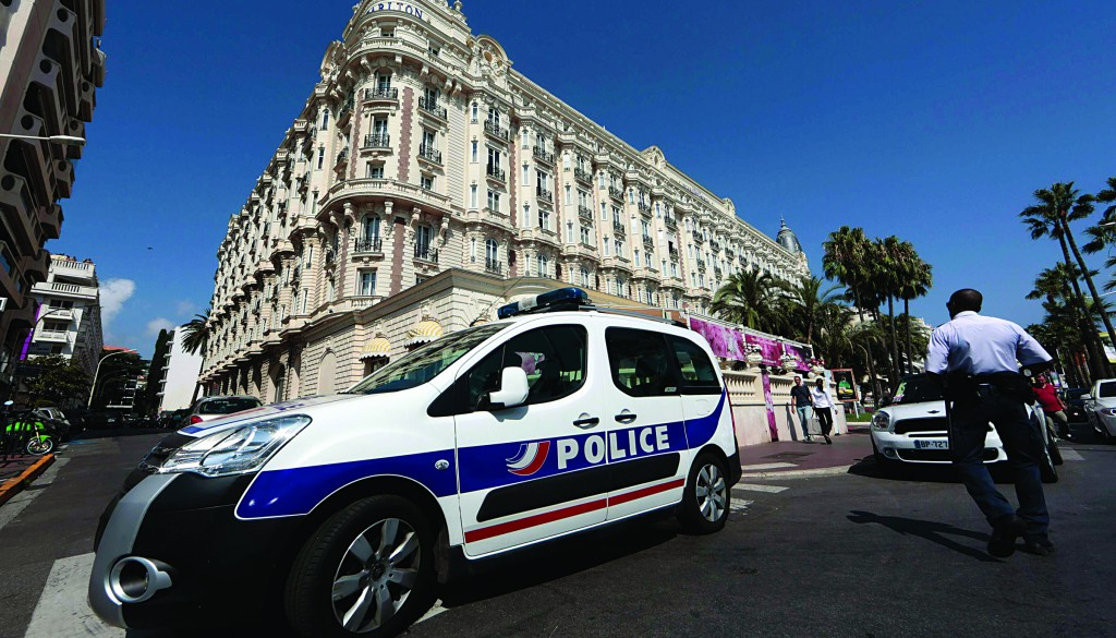 A police car is seen parked outside the Carlton hotel in Cannes on Sunday. (REUTERS/Eric Gaillard)