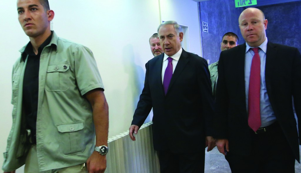 Israel's Prime Minister Binyamin Netanyahu arrives for the weekly Cabinet meeting on Sunday. (Miri Tzahi/POOL/FLASH90)