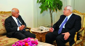 In this image released by the Egyptian Presidency, interim President Adly Mansour, (R), meets with Hazem el-Beblawi, left, in Cairo, Egypt, on Tuesday. (AP Photo/Egyptian Presidency)