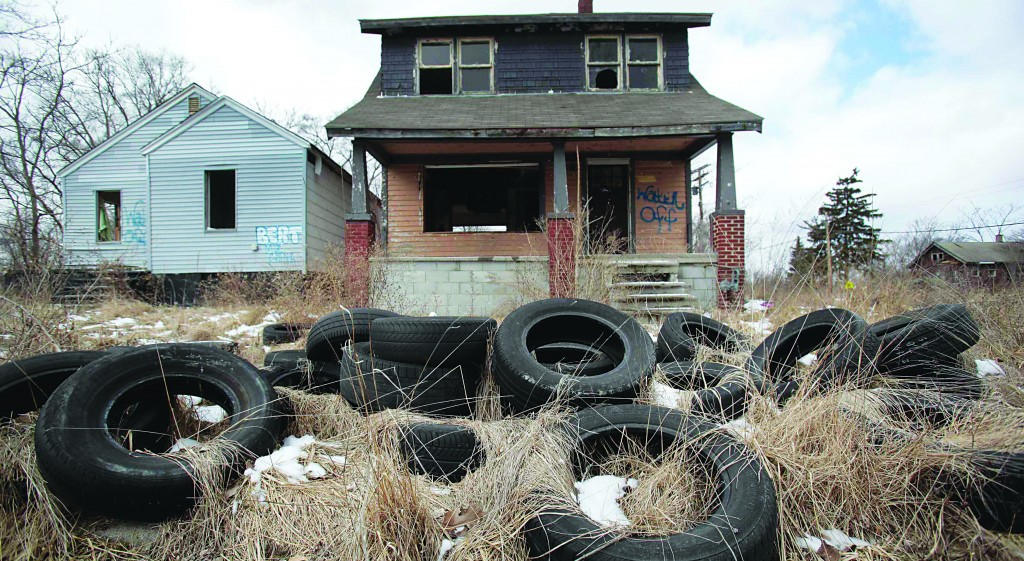 Illegally dumped tires sit in front of a vacant, blighted home in a once-thriving neighborhood on the east side of Detroit, Michigan. (REUTERS/Rebecca Cook/Files)