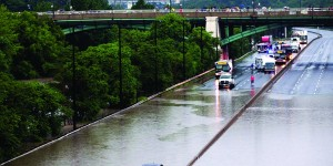 A car is stuck during a flood on the Don Valley Parkway, a major highway in Toronto. (REUTERS/Mark Blinch)