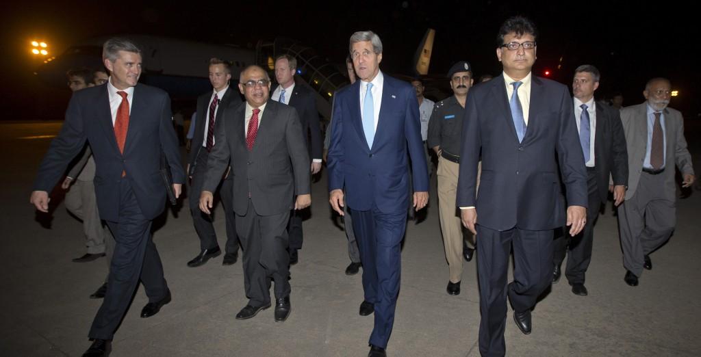 Secretary of State John Kerry walks with unidentified Pakistani officials and U.S. Ambassador to Pakistan Richard Olson, left, upon his arrival in Islamabad, Pakistan, Wednesday. (AP Photo/Jason Reed, Pool)
