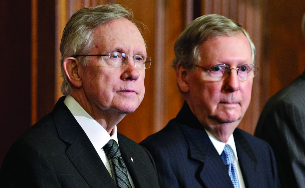 In this July 11, 2012, photo, the Senate Majority Leader, Democrat Harry Reid of Nevada (L), and the Senate Minority Leader, Republican Mitch McConnell of Kentucky, participate in an award ceremony at the U.S. Capitol. (AP Photo/J. Scott Applewhite)