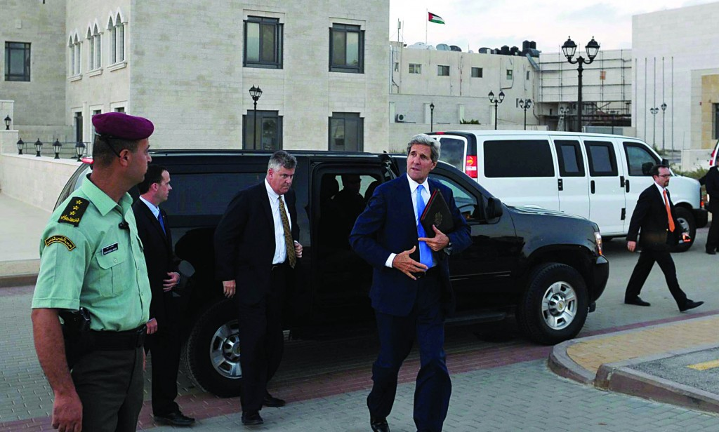 Secretary of State John Kerry steps out of a vehicle after a meeting with Palestinian Authority President Mahmoud Abbas on Friday. (AP Photo/Mandel Ngan, Pool)