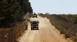 Israeli army vehicles patrol along Israel's border with Lebanon near the northern village of Avivim. (REUTERS/Baz Ratner)