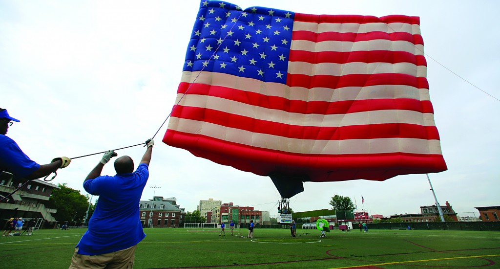 Wayne Matthews holds the line as a flag is inflated at Stevens Institute of Technology in Hoboken, N.J., Wednesday.