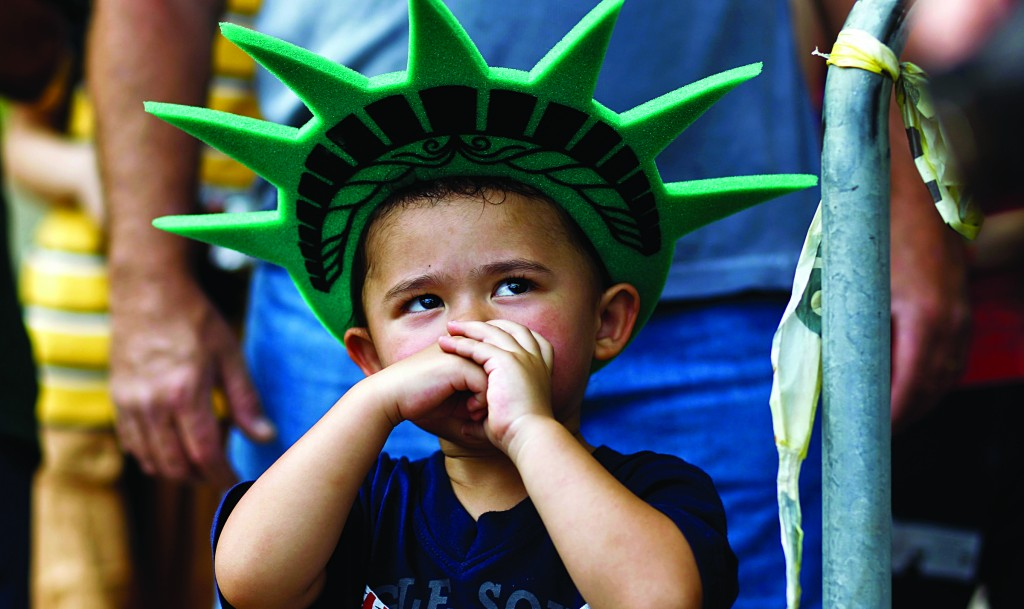 A child attends a ceremony to reopen the Statue of Liberty Thursday.