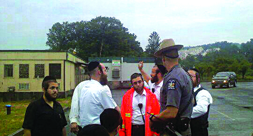 State police and Kiryas Joel Shomrim directing the search Monday morning for 10-year-old Shimon who was found after he had gone missing on Sunday. (JDN)