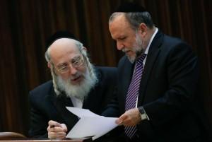 United Torah Judaism MK Rabbi Yisrael Eichler (L) speaking with Shas MK Yitzchak Cohen in the Knesset on Monday. (Miriam Alster/FLASH90)