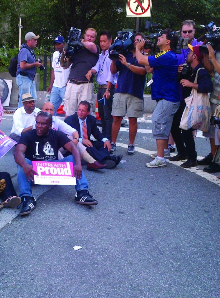 Councilman Brad Lander (D-Brooklyn), seated, right, was arrested Wednesday afternoon after he and other protesters sat down on the Brooklyn Bridge to protest the pending closure of two Brooklyn hospitals. (Pinny Ringel)