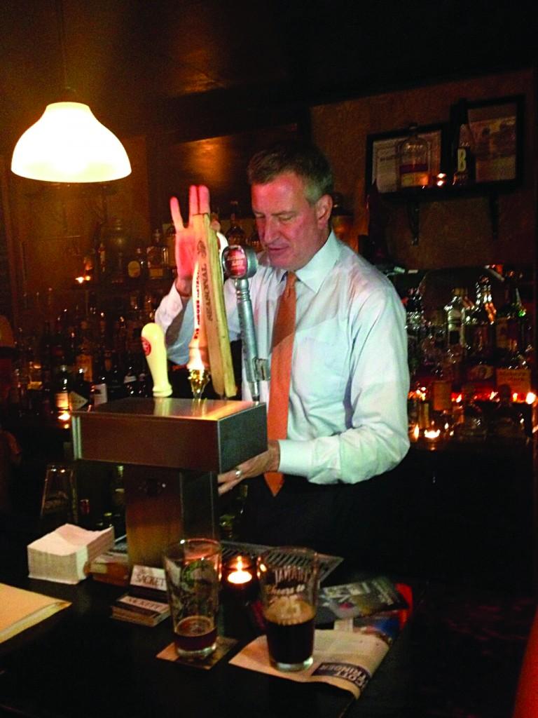 Bill de Blasio celebrating his straw poll win Tuesday night.